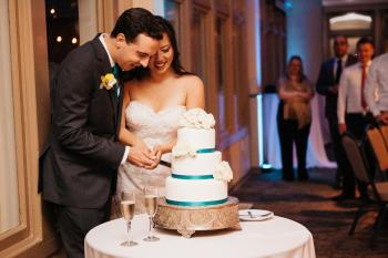 Sweet Couple Sharing Their First Slice - Photo Courtesy of Hewitt Photography